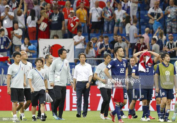 Japan coach Akira Nishino and players leave the pitch after a World Cup roundof16 match against Belgium in RostovOnDon Russia on July 2 2018 Belgium...
