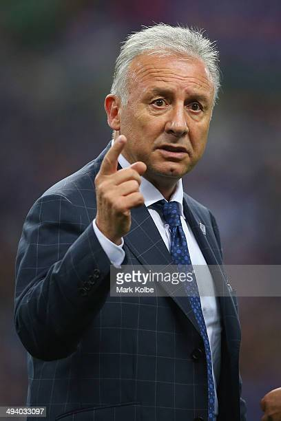 Japan coach Alberto Zaccheroni gestures as he speaks to a member of his coaching staff after the Kirin Challenge Cup international friendly match...