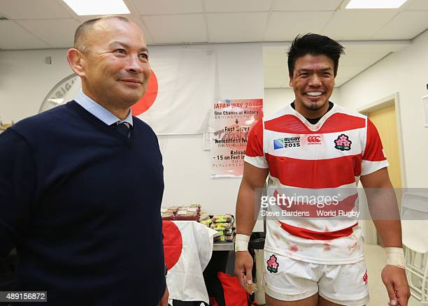 Japan coach Eddie Jones congratulates his player Takeshi Kizu following their surprise victory in the 2015 Rugby World Cup Pool B match between South...