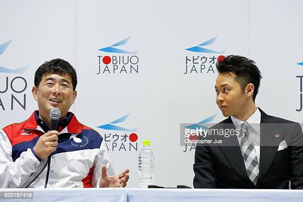 Japan coach Norimasa Hirai and multiple Olympic gold medalist breaststroke swimmer Kosuke Kitajima attend a press conference as Kitajima officially...