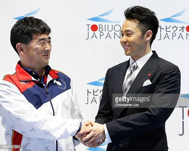 Japan coach Norimasa Hirai and multiple Olympic gold medalist breaststroke swimmer Kosuke Kitajima join hands after Kitajima officially announced his...