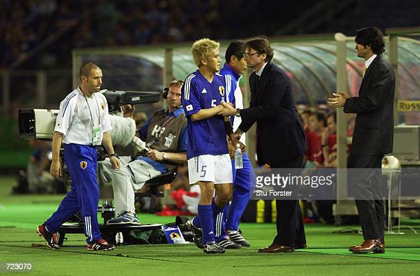 Japan coach Philippe Troussier congratulates goalscorer Junichi Inamoto after he scored the winning goal during the FIFA World Cup Finals 2002 Group...