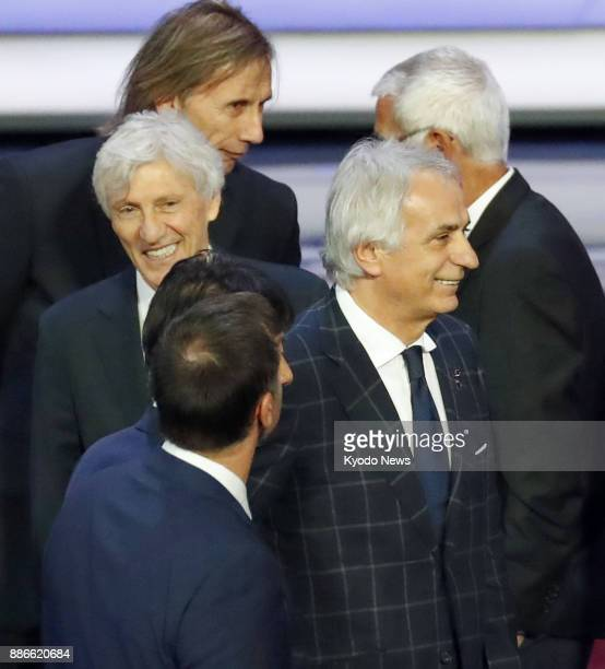 Japan coach Vahid Halilhodzic and Columbia's coach Jose Pekerman wait for a photo session after the draw for the 2018 World Cup finals was held at...