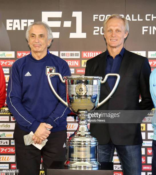Japan coach Vahid Halilhodzic and North Korea coach Jorn Andersen pose after meeting the press in Tokyo on Dec 7 ahead of the men's tournament of the...