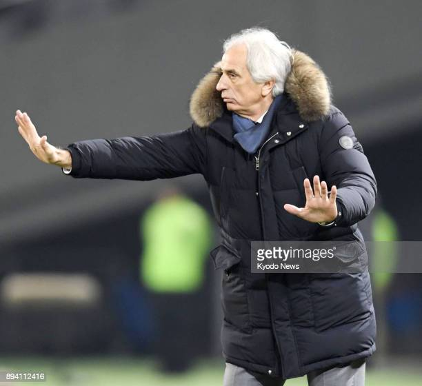 Japan coach Vahid Halilhodzic gives a hand signal during the first half of a match against South Korea in the E1 Football Championship on Dec 16 in...