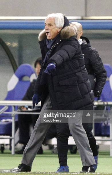 Japan coach Vahid Halilhodzic gives instructions during the second half of a men's match against China of the F1 Football Championship at Ajinomoto...