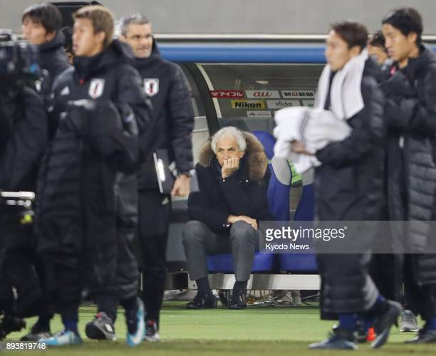 Japan coach Vahid Halilhodzic keeps sitting on the bench after a 41 loss to South Korea in an E1 Football Championship match at Ajinomoto Stadium in...