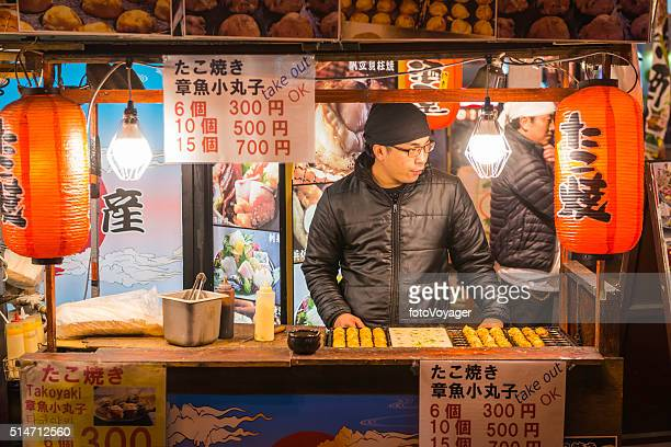 Japan cook selling takoyaki snack food night market stall Osaka