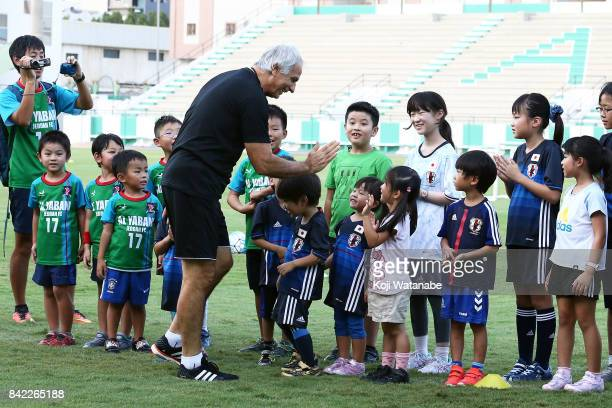 Japan corch Vahid Halilhodzic with chirdren in action during a training session ahead of the FIFA World Cup qualifier against Saudi Arabia at AlAhli...