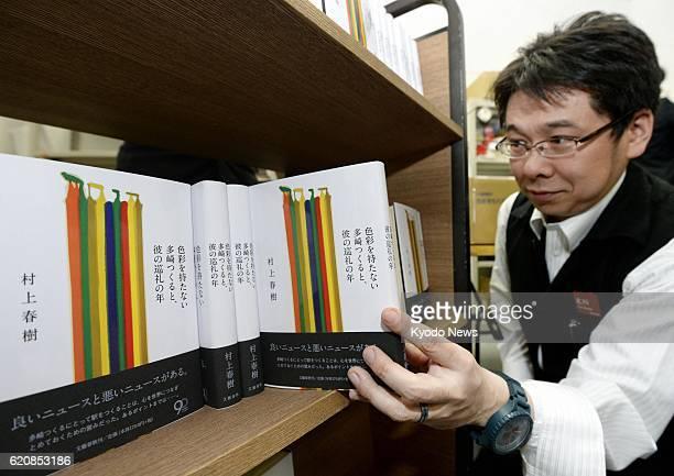 TOKYO Japan CORRECTING JAPANESE TITLE OF BOOK A man shows the new novel of acclaimed Japanese author Haruki Murakami on the shelf of Tsutaya...