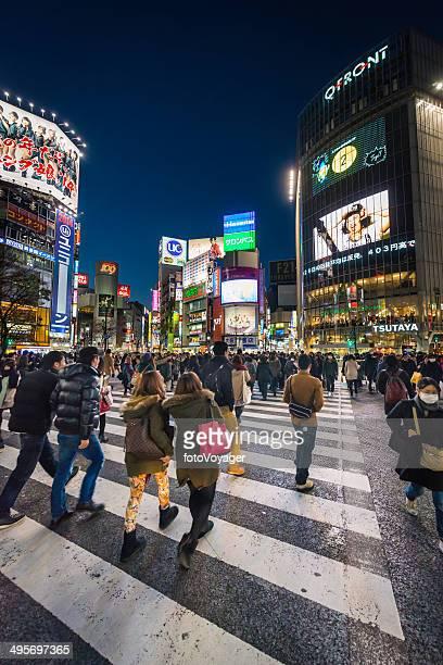 Japan crowds of pedestrians on Shibuya Crossing night neon Tokyo
