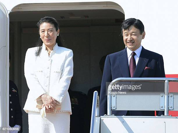 TOKYO Japan Crown Prince Naruhito and Crown Princess Masako board a plane at Tokyo's Haneda airport as they depart for the Netherlands on April 28 to...