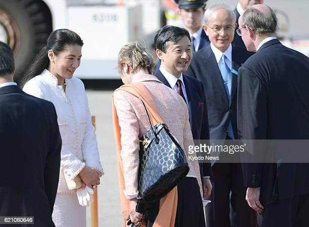 TOKYO Japan Crown Prince Naruhito and Crown Princess Masako exchange words with the Dutch ambassador to Japan and his wife at Tokyo's Haneda airport...