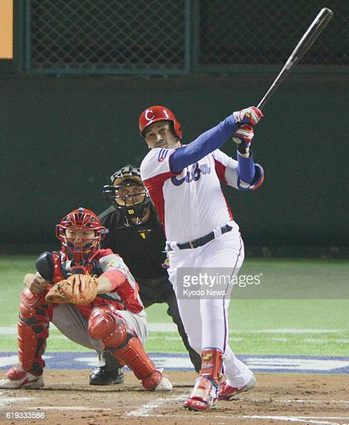 Japan - Cuba's Frederich Cepeda hits a triple during the first inning of a World Baseball Classic first-round game in Pool A against China at Fukuoka...