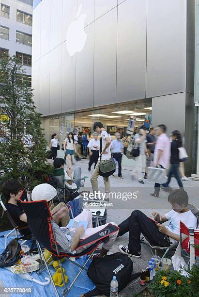TOKYO Japan Customers line up outside Apple Store Ginza in Tokyo on Sept 12 eight days before the new iPhone 5s and iPhone 5c begin selling on Sept 20