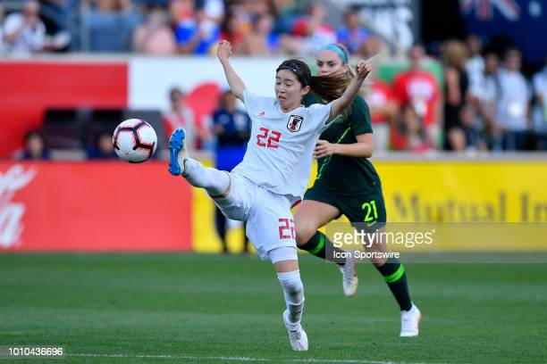 Japan defender Risa Shimizu shoots against Australia defender Ellie Carpenter during the 2018 Tournament Of Nations at Toyota Park on August 2 2018...