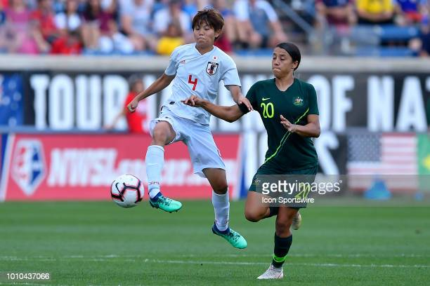 Japan defender Shiori Miyake clears the ball against Australia forward Sam Kerr during the 2018 Tournament Of Nations at Toyota Park on August 2 2018...