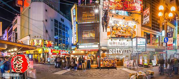 Japan Dotonbori neon nightlife restaurants bars crowded streets panorama Osaka