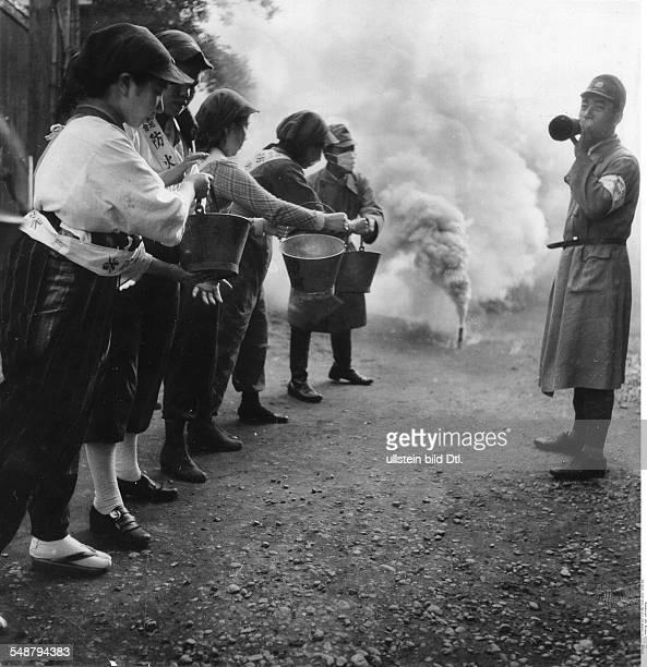 Japan during World War II Women with buckets during an air raid drill 1942 Vintage property of ullstein bild