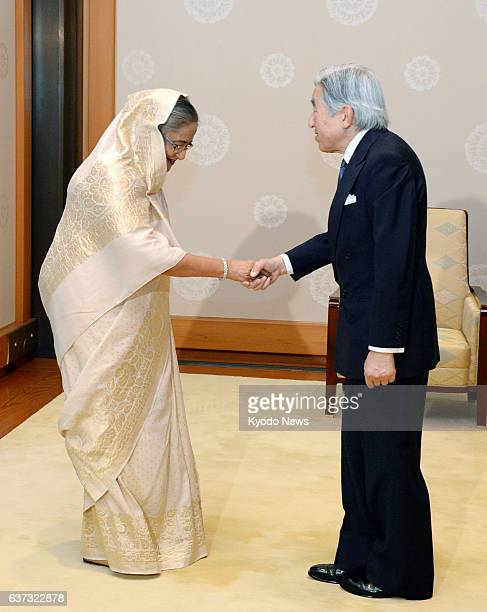TOKYO Japan Emperor Akihito shakes hands with Bangladesh Prime Minister Sheikh Hasina at the Imperial Palace in Tokyo on May 26 2014