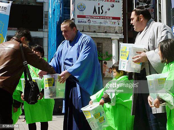 TOKYO Japan Estonian ozeki Baruto and Georgian sumo wrestler Kokkai ask for donations in Tokyo on March 26 to support relief efforts after the March...