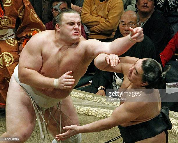 TOKYO Japan Estonian ozeki Baruto charges Mongolian ozeki Harumifuji at Ryogoku Kokugikan in Tokyo on Jan 18 in the New Year Grand Sumo Tournament...