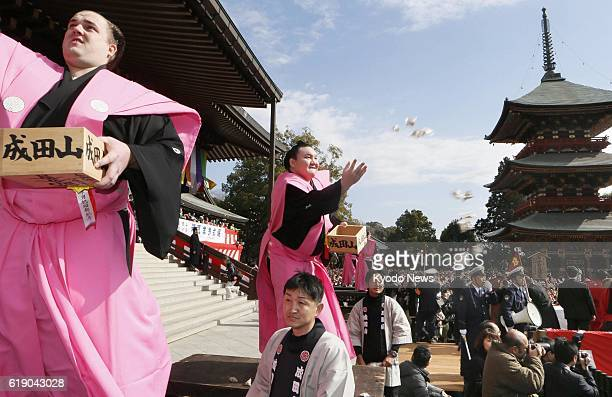 NARITA Japan Estonian sekiwake Baruto and Mongolian grand champion Hakuho throw bags of beans during the annual beanthrowing festival marking the...