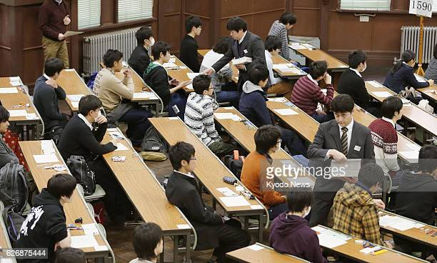 Japan - Examinees sit for taking the unified college entrance examinations at the University of Tokyo on Jan. 18 as the two-day event began across...