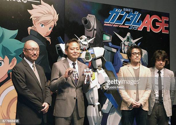 TOKYO Japan Executives of Bandai Namco Holdings Inc and animation creators line up during a promotional event in Tokyo to unveil the story and...