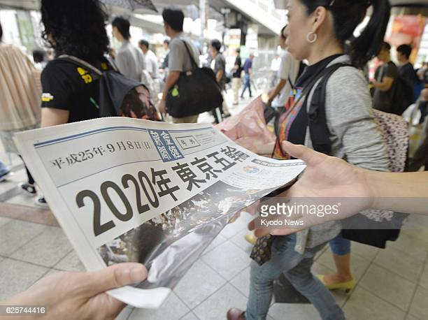 OSAKA Japan Extra edition copies of a newspaper are given to passersby outside JR Osaka Station in Osakaw western Japan on Sept 8 after Tokyo was...