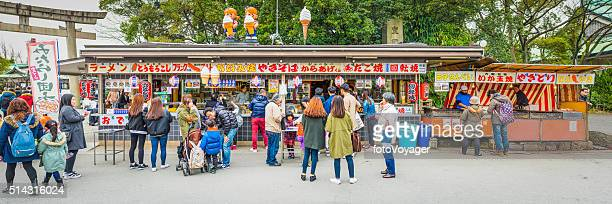 Japan families and tourists at food stand Osaka Castle Park