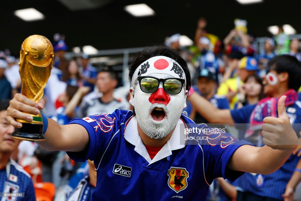 Japan fan cheers before the Russia 2018 World Cup Group H football match between Colombia and Japan at the Mordovia Arena in Saransk on June 19, 2018. (Photo by Jack GUEZ / AFP) / RESTRICTED