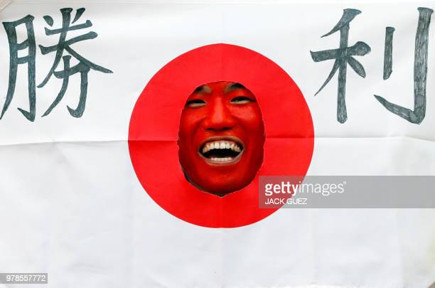 Japan fan laughs before the Russia 2018 World Cup Group H football match between Colombia and Japan at the Mordovia Arena in Saransk on June 19 2018...