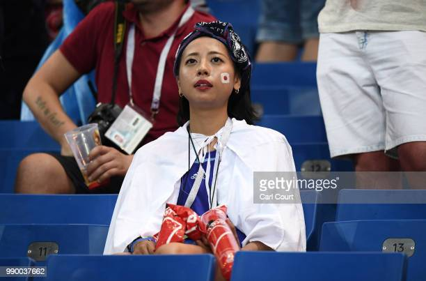 Japan fan looks dejected following her side's defeat in the 2018 FIFA World Cup Russia Round of 16 match between Belgium and Japan at Rostov Arena on...