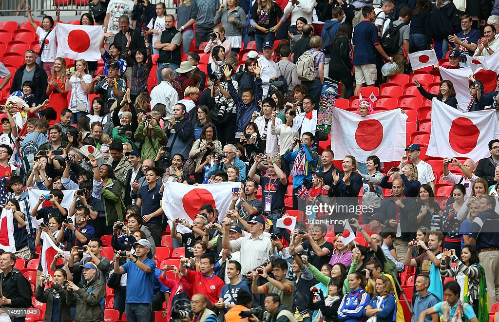 Japan fans celebrate after the Women's Football Semi Final match between France and Japan on Day 10 of the London 2012 Olympic Games at Wembley Stadium on August 6, 2012 in London, England.