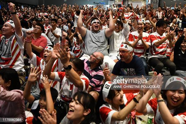 Japan fans celebrate at the fanzone area in Tokyo on October 13 during the Japan 2019 Rugby World Cup Pool A match between Japan and Scotland in...