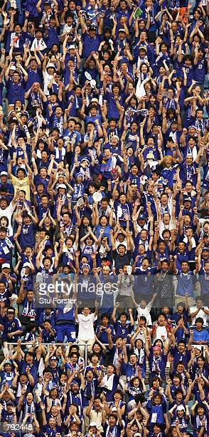 Japan fans celebrate the second goal going in during the FIFA World Cup Finals 2002 Group H match between Japan and Tunisia played at the OsakaNagai...