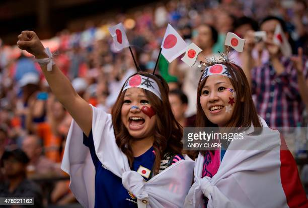 Japan fans cheer as the team comes on the pitch prior to their game against Netherlands during the round of 16 football match between Japan and the...