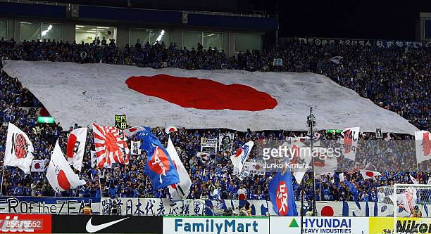 Japan fans cheer during the 2010 FIFA World Cup Asian qualifier match between Japan and Bahrain at Saitama Stadium on March 28 2009 in Saitama Japan
