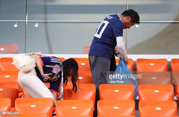 Japan fans clean up the rubbish left in the stands after the 2018 FIFA World Cup Russia group H match between Japan and Senegal at Ekaterinburg Arena...