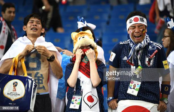 Japan fans look dejected following their sides defeat in the 2018 FIFA World Cup Russia Round of 16 match between Belgium and Japan at Rostov Arena...