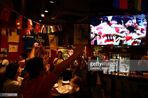 TOPSHOT Japan fans react as they watch the Japan 2019 Rugby World Cup Pool A match between Japan and Ireland in a pub in Oita on September 28 2019