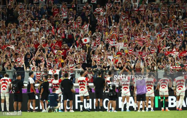 Japan fans salute their team after the Rugby World Cup 2019 Group A game between Japan and Scotland at International Stadium Yokohama on October 13,...