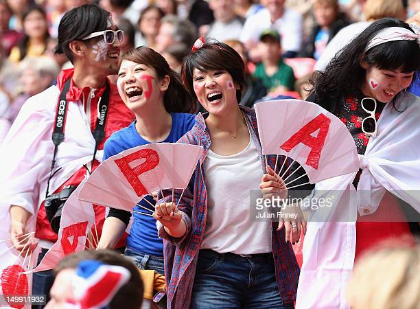 Japan fans show their support during the Women's Football Semi Final match between France and Japan on Day 10 of the London 2012 Olympic Games at...