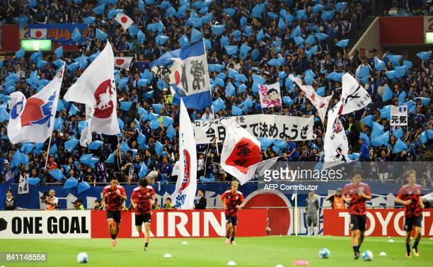 Japan fans waive flags prior to the group B World Cup 2018 qualifying football match between Japan and Australia in Saitama on August 31 2017 / AFP...