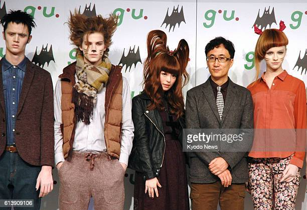 TOKYO Japan Fashion model and singer Kyary Pamyu Pamyu and Osamu Yunoki president of lowprice casual clothing retail chain GU Co attend a media event...