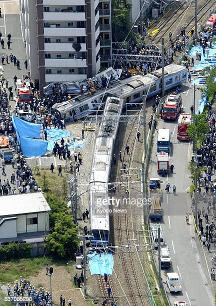 AMAGASAKI Japan File photo shows an aerial view of the derailment site of a West Japan Railway Co train on the Fukuchiyama Line in Amagasaki Hyogo...