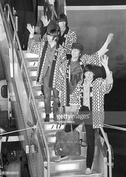 TOKYO Japan File photo shows the Beatles wearing Japanese happi coats and waving to fans upon arrival at Tokyo's Haneda airport in June 1966