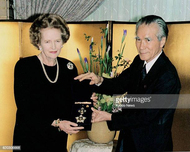 TOKYO Japan File photo taken in May 1995 shows former British Prime Minister Margaret Thatcher being presented with the Order of the Precious Crown...