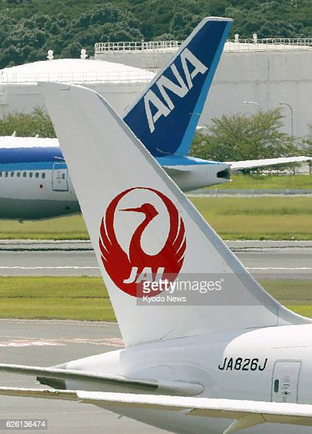 Japan - File photo taken in September 2012 at Narita airport, near Tokyo, shows the tails of a Japan Airlines plane and an All Nippon Airways plane....